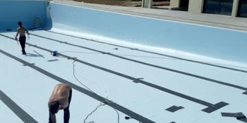ZONE 3 - Mise en place de la membrane en PVC armée de fibre de verre et traçage des lignes de nage (1er avril 2019)